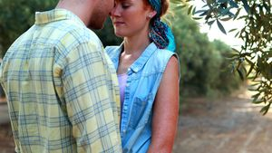 Couple embracing face to face in olive farm