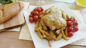 Roasted chicken with cherry tomato in tray