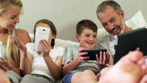 Family using electronic devices in bedroom at home 4k
