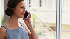 Female business executive talking on mobile phone 4k