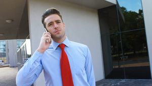 Male executive talking on mobile phone 4k