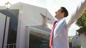 Businessman standing with arms outstretched 4k