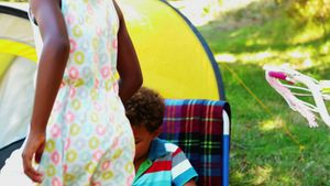 Kids having fun in tent on a sunny day