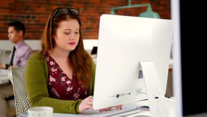 Woman working on computer 4k