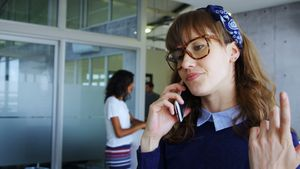 Female executive talking on mobile phone 4k