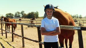 Portrait of girl standing with arms crossed in ranch 4k