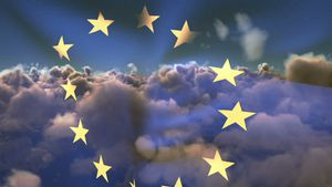 Flag of Europe waving against sky and clouds 4k