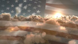 Flag of the United States waving against sky and clouds 4k