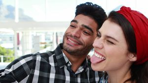 Couple taking selfie with mobile phone in office 4k