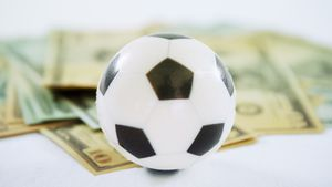 Football and dollar against white background 4k