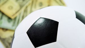 Football and dollar on white background 4k