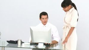 Business coworkers at a computer