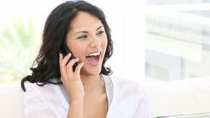 Positive business woman on phone