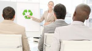 Positive business woman presenting the concept of recycling