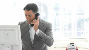 Charming business man talking on phone
