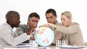 A meeting of business people around a terrestrial globe