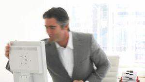 Happy business man working at a computer