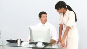Etnic business woman helping a colleague