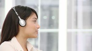 Ethnic business woman talking on headset