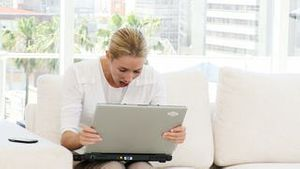 Happy businesswoman working at laptop