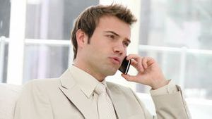 Charming businessman talking seriously on phone