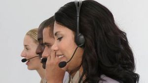 Smiling business team using headset