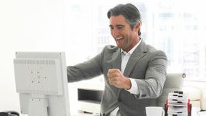 Successful businessman working at a computer
