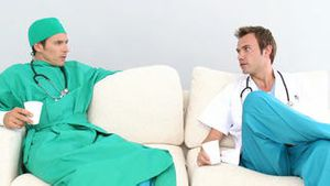Two male doctors in a staff room