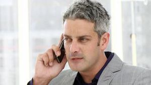 Mature businessman talking on phone