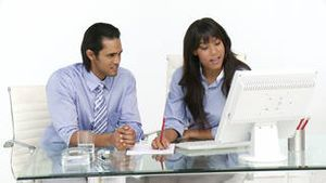 Animated business people working at a computer