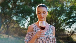 Woman smelling red wine 4k