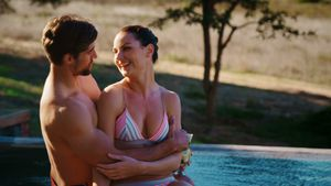 Couple relaxing in pool during safari vacation 4k
