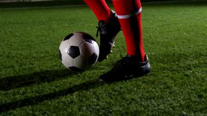 Low section of soccer player and ball on field 4k
