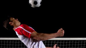 Confident soccer player juggling ball 4k