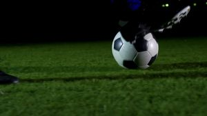 Soccer player dribbling with ball 4k