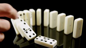 Person touching dice on black background 4k