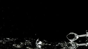 Champagne glass falling on black background 4k