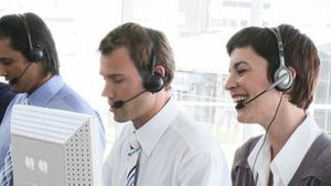 Smiling business team working in a call centre