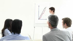 Positive business woman presenting a graph