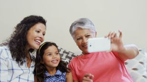 Happy family taking a selfie on mobile phone in living room 4k