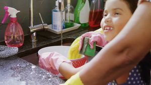 Girl and grandmother washing dishes in the sink 4K 4k