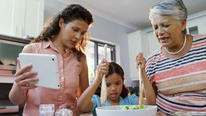 Mother and granny assisting little girl to mix the salad 4K 4k