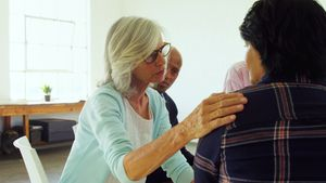 Senior therapist consoling a patient 4k