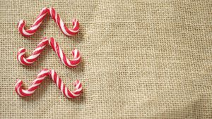 Candy cane arranged on textile 4k