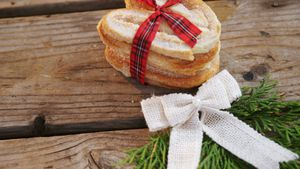 Stack of sweet food tied with ribbon 4k