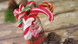 Candy canes arranged in a jar 4k