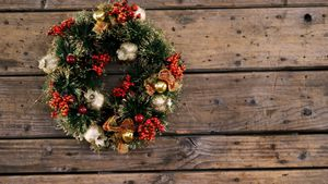 Christmas wreath on wooden table 4k