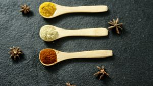 Star anise with various spices powder in wooden spoon 4k
