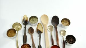Various type of spoons with spices in bowl 4k
