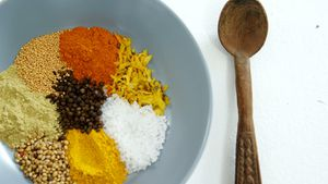 Various spices arranged in plate with spoon 4k